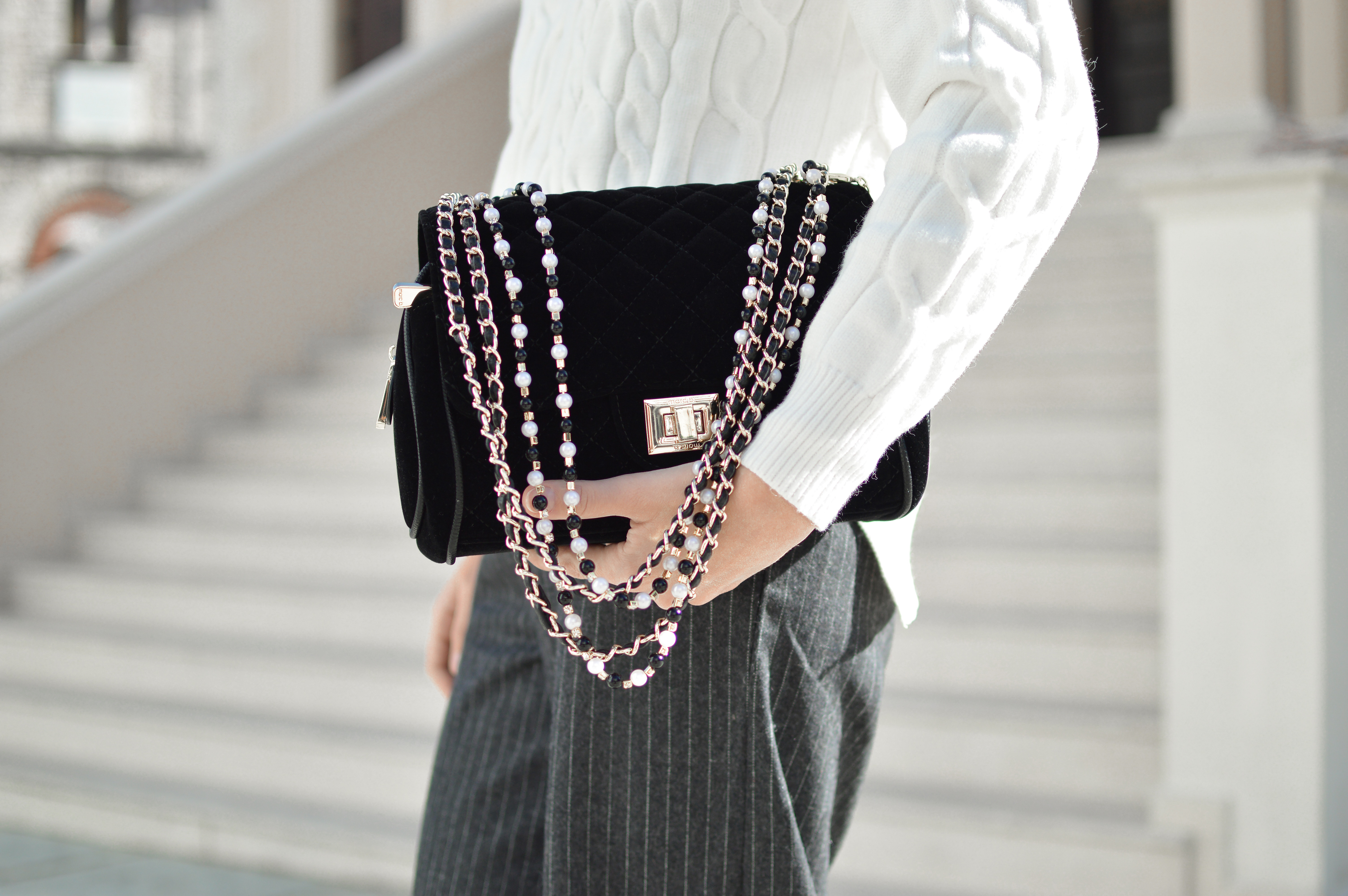 woman clutching handbag under arm