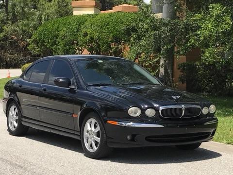 Black Jaguar parked in street